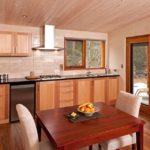 Beautiful handmade table with custom wood kitchen behind.
