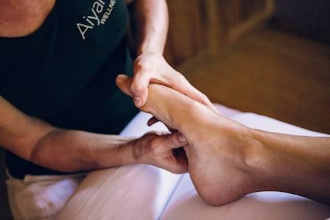 Hands massaging feet.
