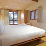 The crisp white sheets and fluffy pillows looking out to the courtyard of the bedroom of Mira Villa.