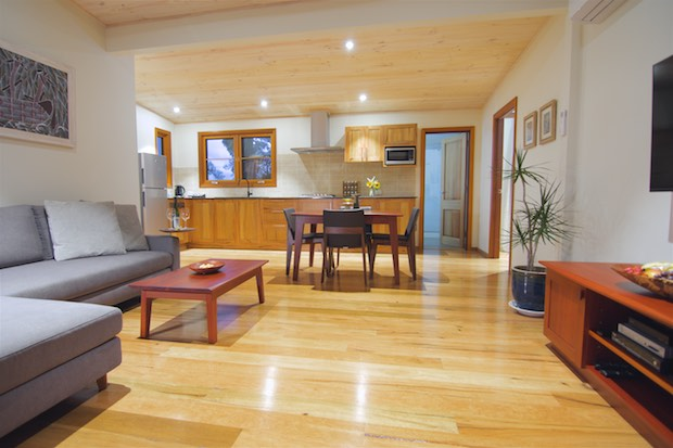 Beautiful wooden floors and welcoming sofa of Mira villa.