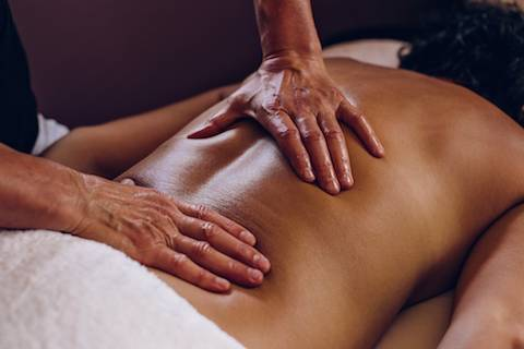 Hands on a bare back