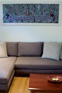 An Aboriginal art piece above the lounge.